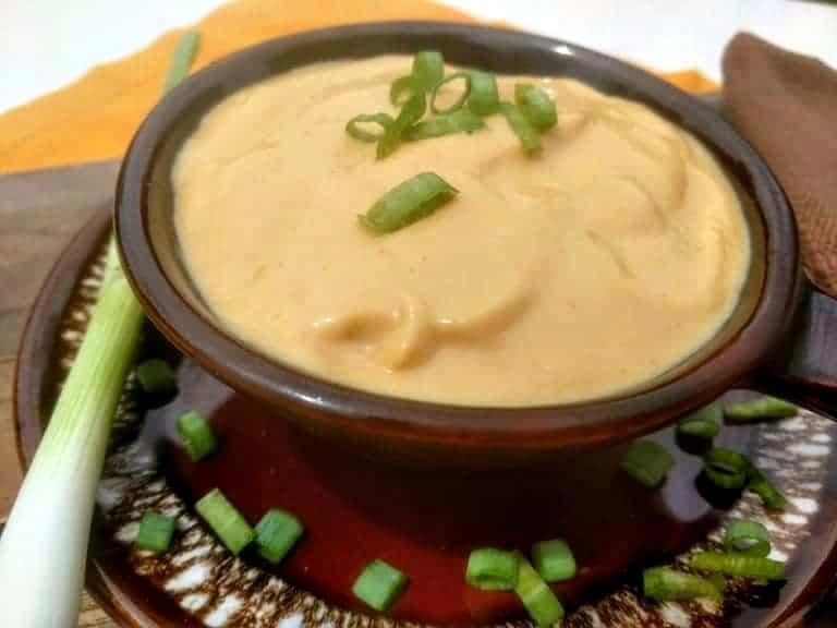 vegan cheese sauce in brown crock bowl