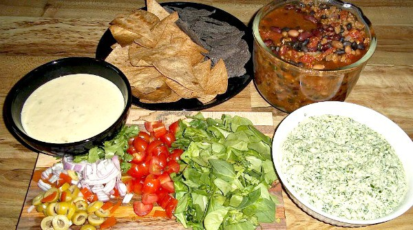 vegan nacho toppings veggies, spinach dip, beans