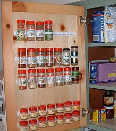 spice clips installed on cabinet door.
