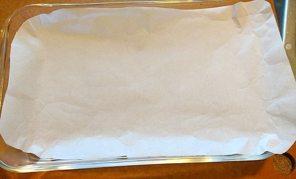 glass baking dish lined with parchment paper