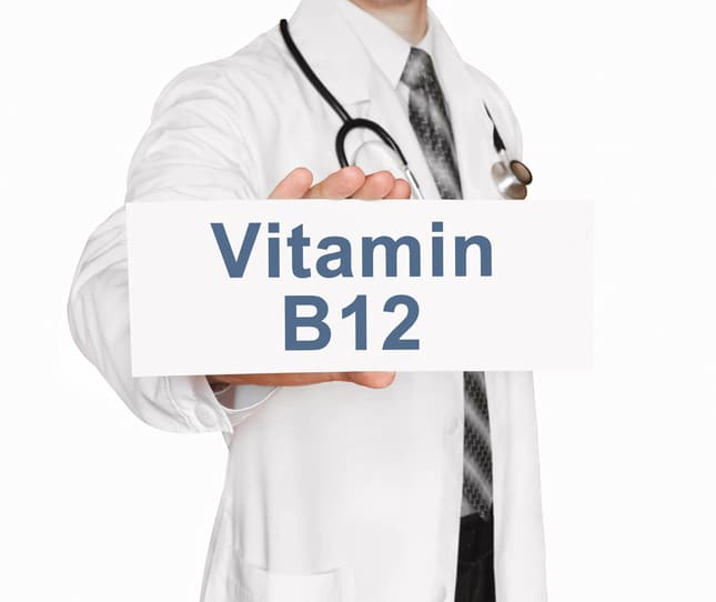 b12 supplements for vegans . doctor holding card.