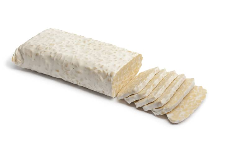 Fresh tempeh with slices on white background