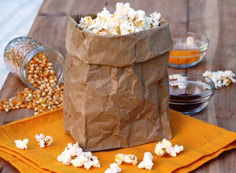 healthy popcorn toppings. brown bag of popcorn.