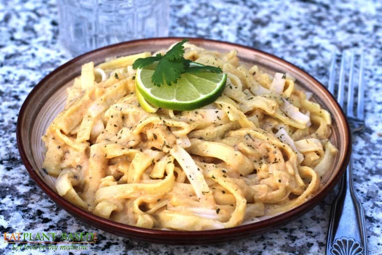 Roasted Garlic Pasta on brown plate with lime.