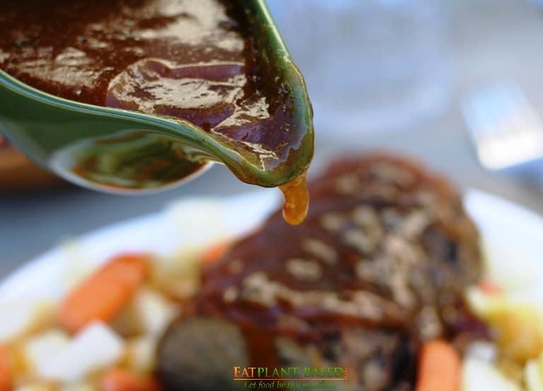 vegan brown gravy poured over mushroom loaf
